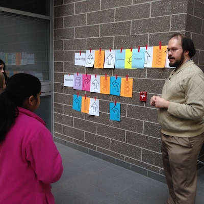 Girls Math & Science Day 2017- Learning to code by guiding their friends through a maze